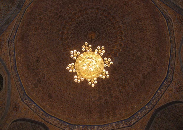 Intricate tiles and chandeliers inside an Uzbek mosque <br /><p id=