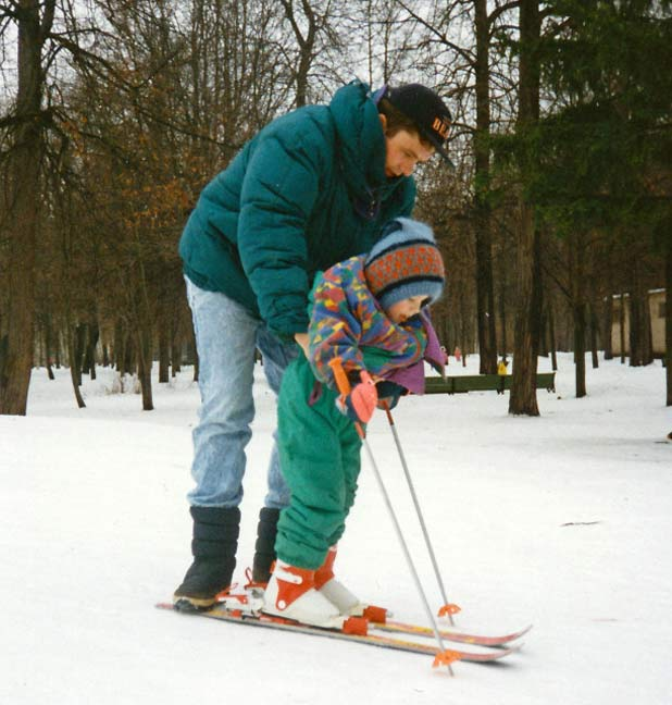 A father guides his daughter – her first time on skis – in a snowy park outside my apartment in Moscow, Russia Photo credit: Helen Holter Jan 1994