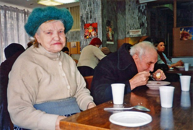 Russians Alexandria Kunitsina and her husband Michael share lunch together at a Moscow soup kitchen in 1994 <br /><p id=