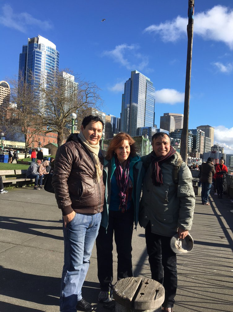 It's a sunny Seattle Saturday along the windy waterfront, with shiny skyscrapers in the background Elyorjon Ehsonov, Helen Holter, A'zam Obidov (February 17, 2018)