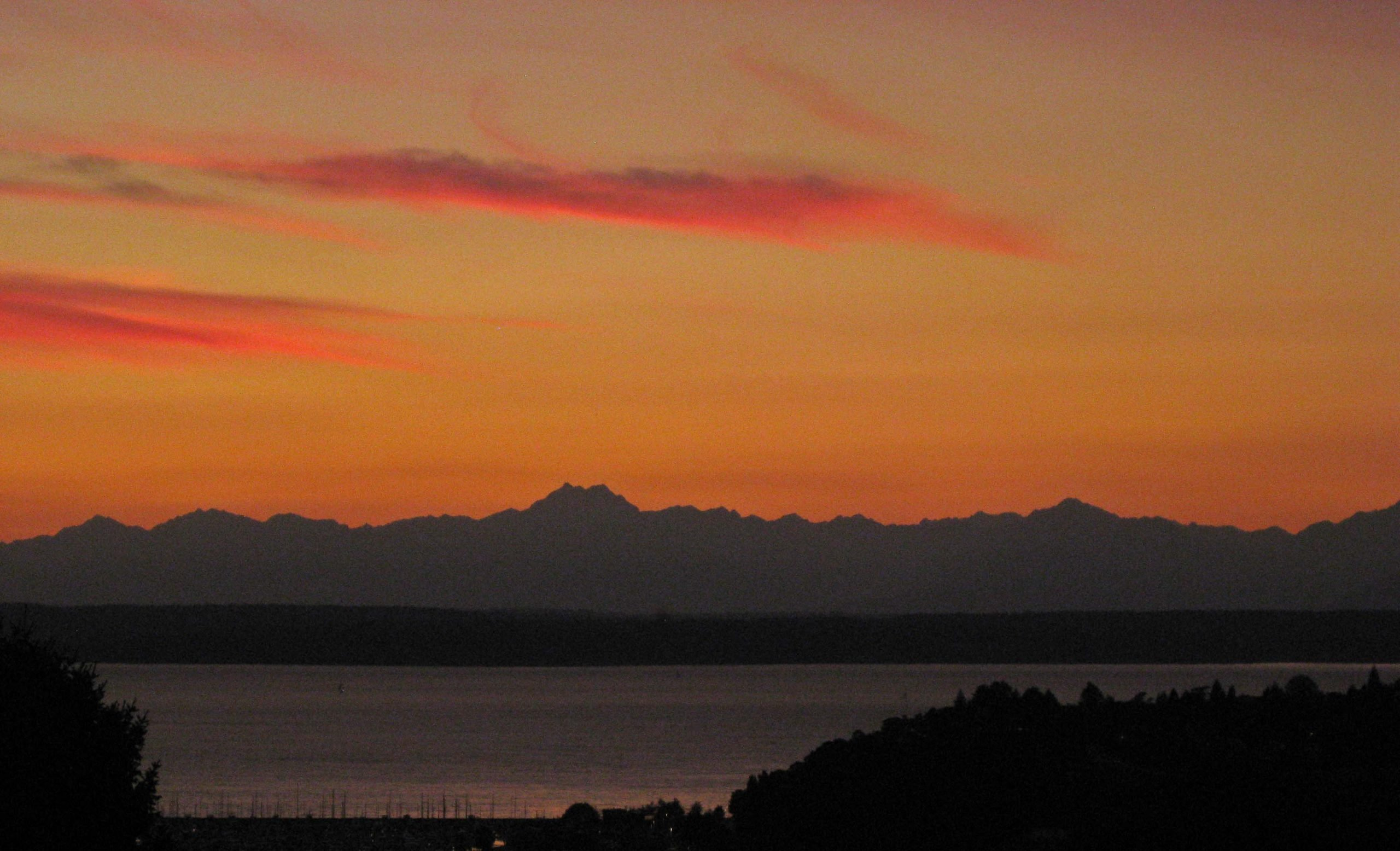 Sunset over the Olympic Mountains. (Seattle, October 2012)