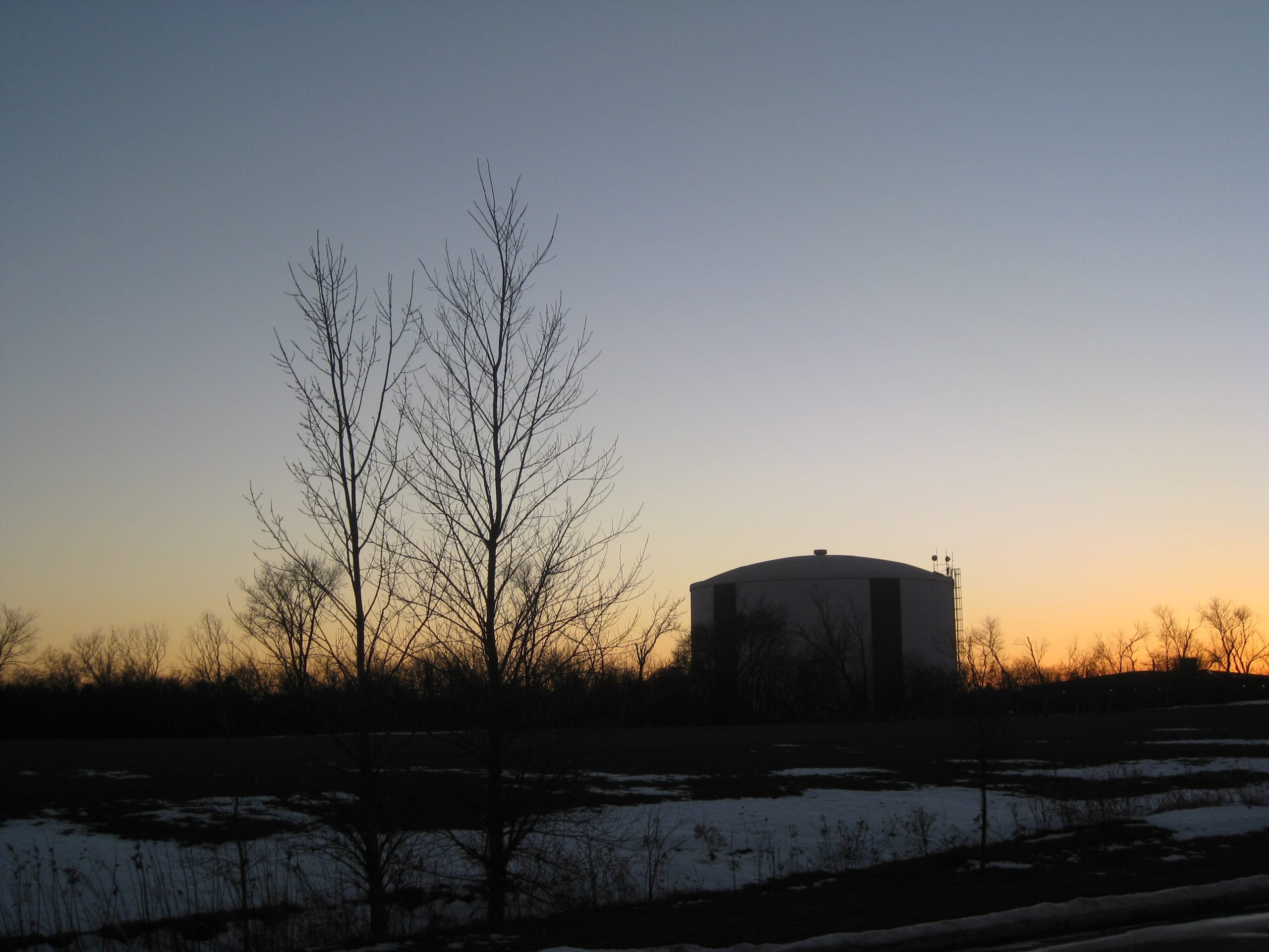 Sunset from my mother's place at the assisted living residence in Racine, Wisconsin. Yes, they still have silos, farms, and dairy cows...